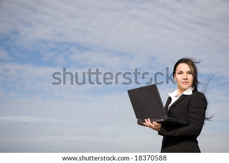 attractive brunette businesswoman over sky background - stock photo