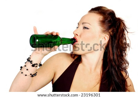 attractive brunette drinking a bottle of beer - stock photo
