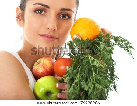 attractive brunette female holds bunch of fruits and vegetables, isolated on white - stock photo