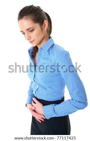 attractive brunette female suffers from stomachache, holds her hand on her belly, isolated on white - stock photo