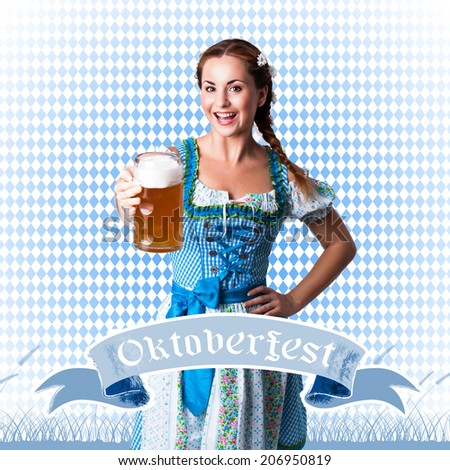 attractive brunette girl in a dirndl with a beer - stock photo