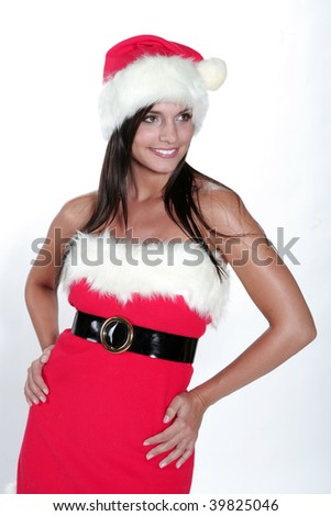 Attractive brunette girl in santa cloth smilling in front of a white background - stock photo