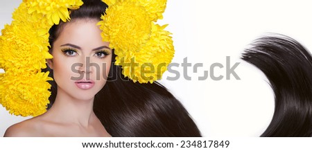Attractive brunette girl. Long healthy hair styling. Studio portrait. Banner for Salon of Beauty. - stock photo