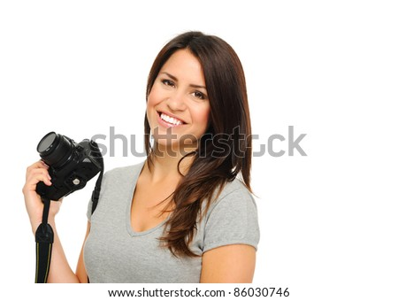 Attractive brunette holding and posing with  DSLR camera in studio, isolated on white - stock photo