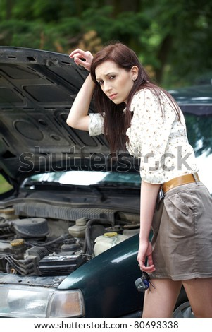 attractive brunette in front of her car broken down car, assistance concept - stock photo