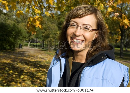 Attractive brunette in the park on the fall - stock photo