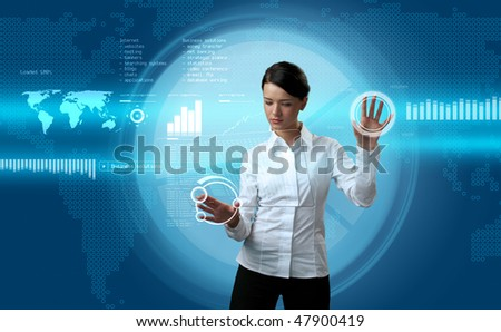 Attractive brunette navigating futuristic interface (outstanding business people in interiors / interfaces series) - stock photo