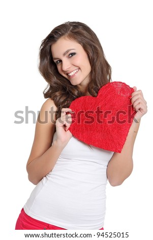 Attractive brunette showing a big heart - stock photo