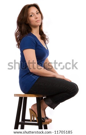 attractive brunette sitting on a stool