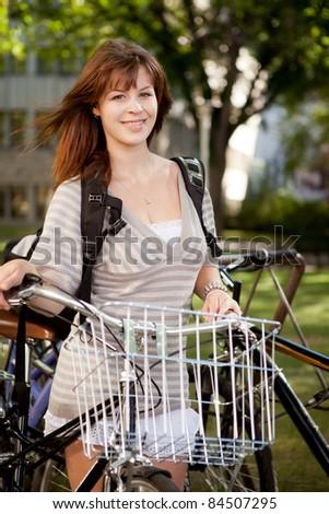 Attractive brunette student with retro bike - stock photo