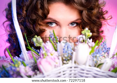 Attractive brunette with a bouquet of flowers close-up - stock photo