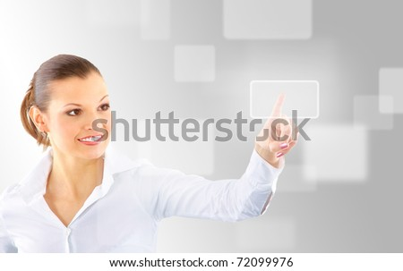 Attractive brunette with interface in futuristic interior - stock photo