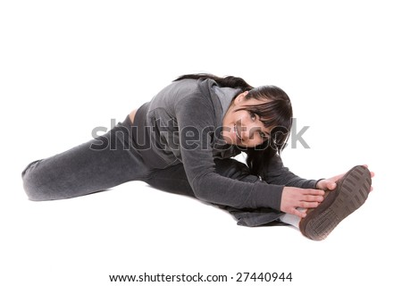 attractive brunette woman doing exercise. over white background