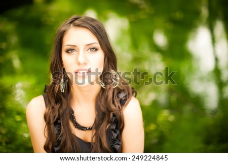 Attractive brunette woman dramatic beauty portrait in nature.Sexy woman in black lace elegant dress smiling.Sexy vamp femme fatale sensual lady.Perfect fresh skin.Pure beauty model girl.Prom girl - stock photo