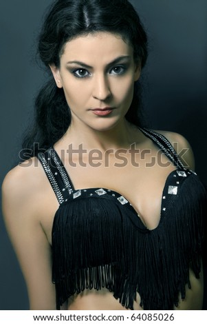 Attractive brunette woman in black bra. Portrait of beautiful looking girl. - stock photo