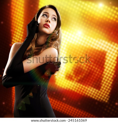 attractive brunette woman in front of light wall - stock photo