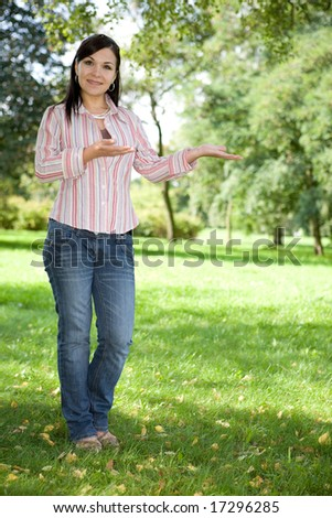 attractive brunette woman in park