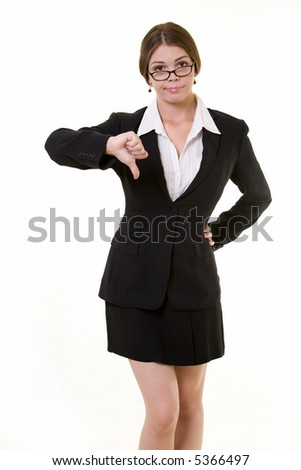 Attractive brunette woman in professional business suit standing on white pointing her thumb down - stock photo