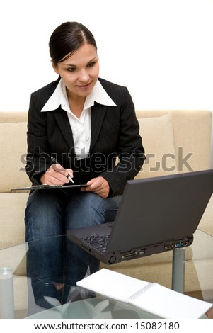 attractive brunette woman on sofa with laptop