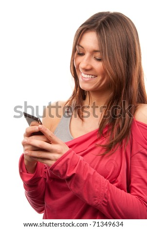 Attractive brunette woman reading, typing and sending SMS text message on mobile cellphone smiling and laughing isolated on a white background