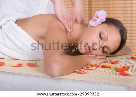 attractive brunette woman relaxing in massage