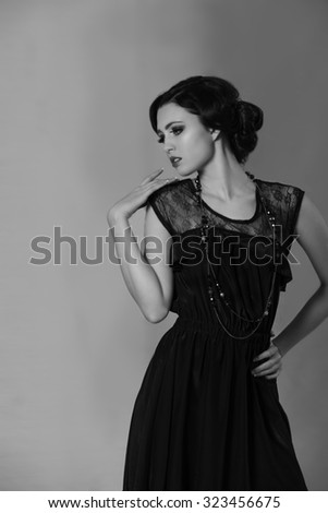 Attractive brunette woman resembling Coco Chanel - stock photo