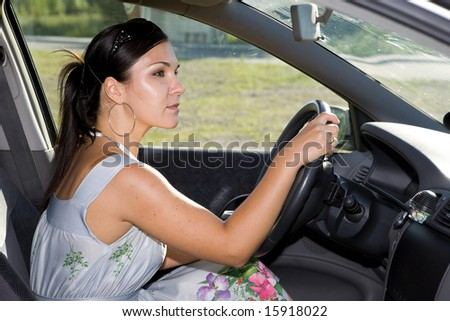attractive brunette woman traveling by car