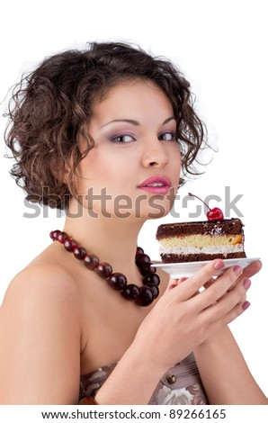 Attractive brunette woman with a cake