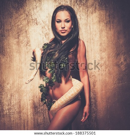 Attractive brunette woman with albino python - stock photo
