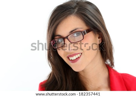 Attractive brunette woman with red jacket and eyeglasses - stock photo