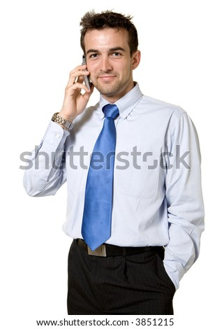 Attractive brunette young business man wearing blue shirt and tie standing on white talking on a cellular phone