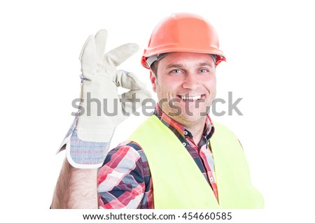 Attractive builder doing ok or perfect gesture as great construction services concept isolated on white - stock photo