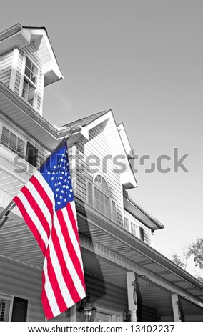 Attractive building with American flag hanging out front - stock photo