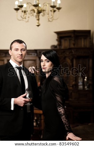 Attractive business couple smiling while is having a drink. Please see more images from the same shoot. - stock photo