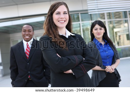 Attractive business man and women team at office building - stock photo