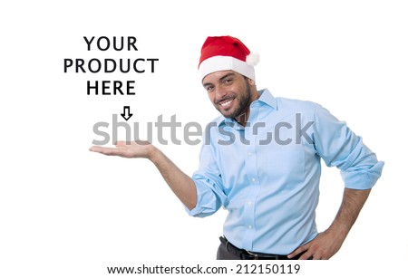 attractive business man in santa hat  showing blank copy space above palm hand for client to add christmas product, present, gift, greeting and wishes text, looking happy and excited isolated on white - stock photo