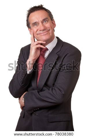 Attractive Business Man in Suit with Silly Grin Holding Hand to Face - stock photo