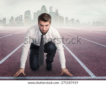 Attractive business man is ready for the start - stock photo