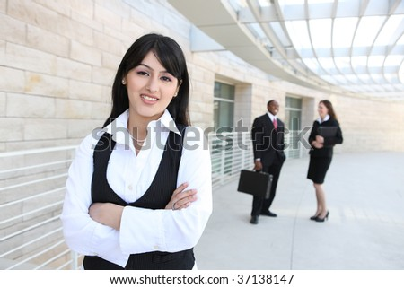 Attractive business men and women at office building - stock photo