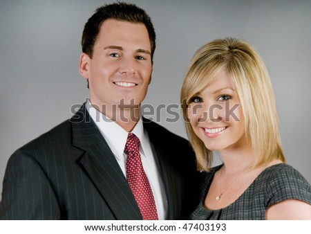 Attractive business partners in professional attire - stock photo