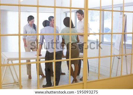 Attractive business people speaking with each other and discussing business matters together - stock photo