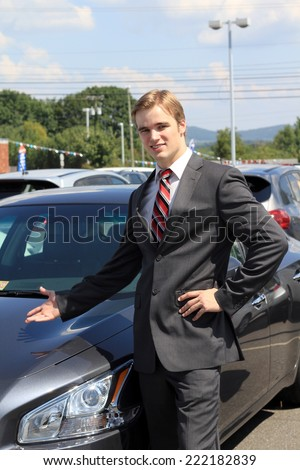 Attractive Business Professional Business Man Car Salesman Wearing Suit Blonde