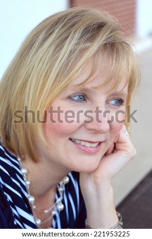 Attractive Business Professional Business Woman Smiling and Looking to the Side  - stock photo