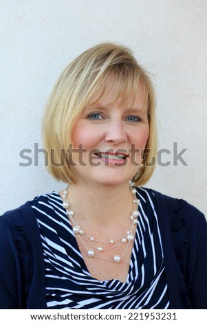 Attractive Business Professional Business Woman Smiling and Mature Happy Baby Boomer Middle Age Mother  - stock photo