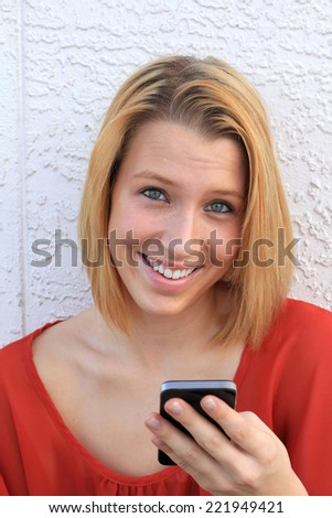Attractive Business Professional Business Woman Texting on the Phone Smiling College Student Teen - stock photo