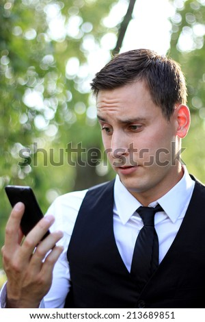 Attractive Business Professional Man on the Phone Looking Confused and Having a Confused Expression on Face  - stock photo