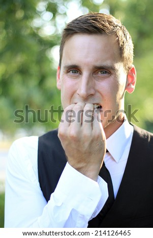 Attractive Business Professional Nervous and Upset Chewing Fingers - stock photo