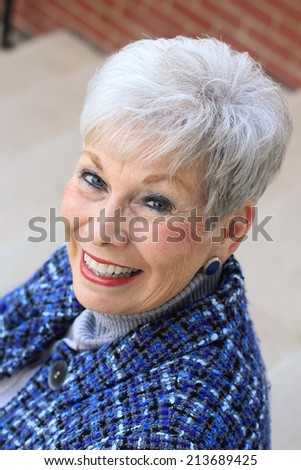 Attractive Business Professional Smiling and Looking At The Camera - stock photo