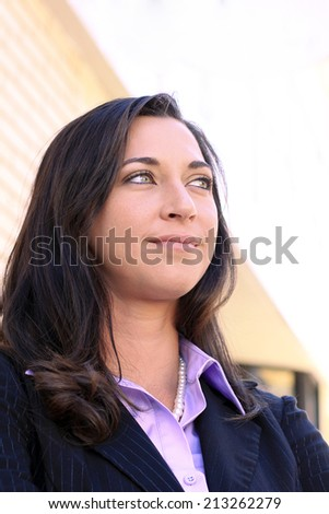 Attractive Business Professional Woman Smiling and Looking Confidently to the Side - stock photo