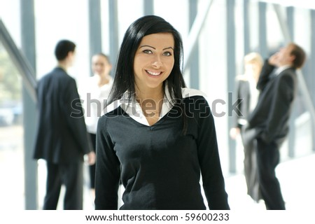 attractive business woman and her team - stock photo